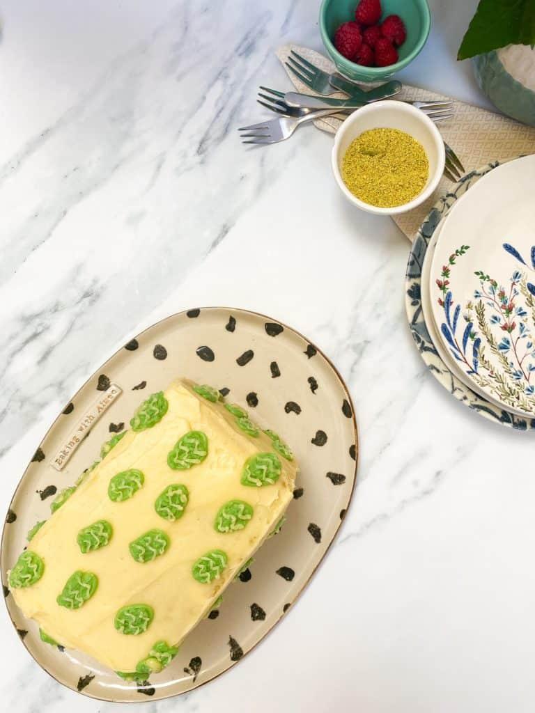 raspberry pistachio and white chocolate cake on platter