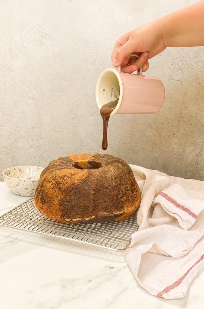 ganache pouring onto cake